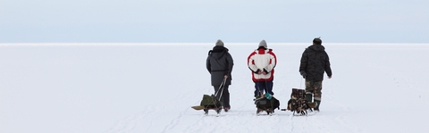 Three Men Pullling Ice Fishing Sled