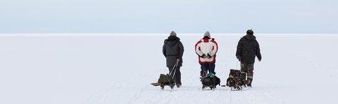 Three Men Pullling Ice Fishing Sled